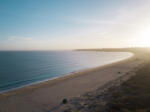 Aerial photography shot with a drone of a beach in Meia Praia, Portugal