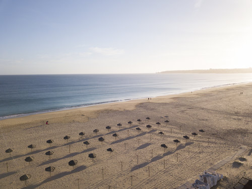 Arial photo shot by a drone of the beach in Meia Praia, Portugal, for a boutique-hotel built by MGB Development